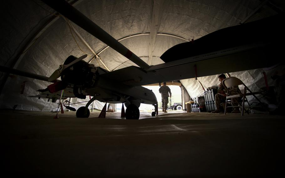Mechanics work on the UAS or Tactical Unmanned Aerial Vehicle, at Camp Ripley in Little Falls, Minnesota, July 19, 2012.