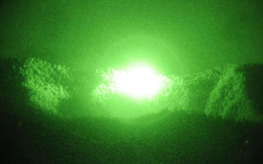 In this file photo from 2011, the explosion from an airstrike on an insurgent location near Jani Kheyl lights up the night sky.