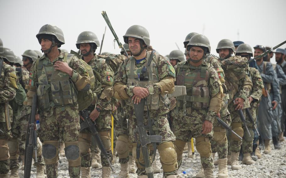 Soldiers from the 1st Brigade, 205th Afghan National Army Corps prepare for training in Kandahar province, Afghanistan, in March 2012.