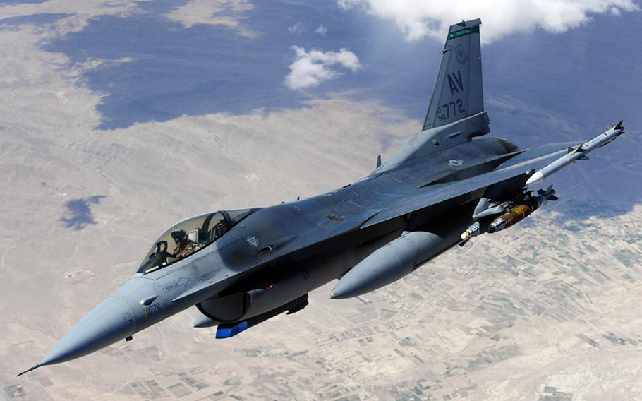 An F-16 Fighting Falcon from Aviano Air Base, Italy, moves away after receiving fuel from a KC-135 Stratotanker over Afghanistan in this March 2011 photo.