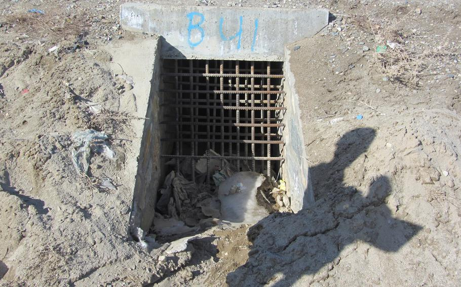 A culvert showing a so-called culvert denial system -- grates to block insurgents from placing bombs in culverts running under roads. A report released by the Special Inspector General for Afghanistan Reconstruction on Julyu 23, 2013, detailed fraud and negligence in the installation of the systems.