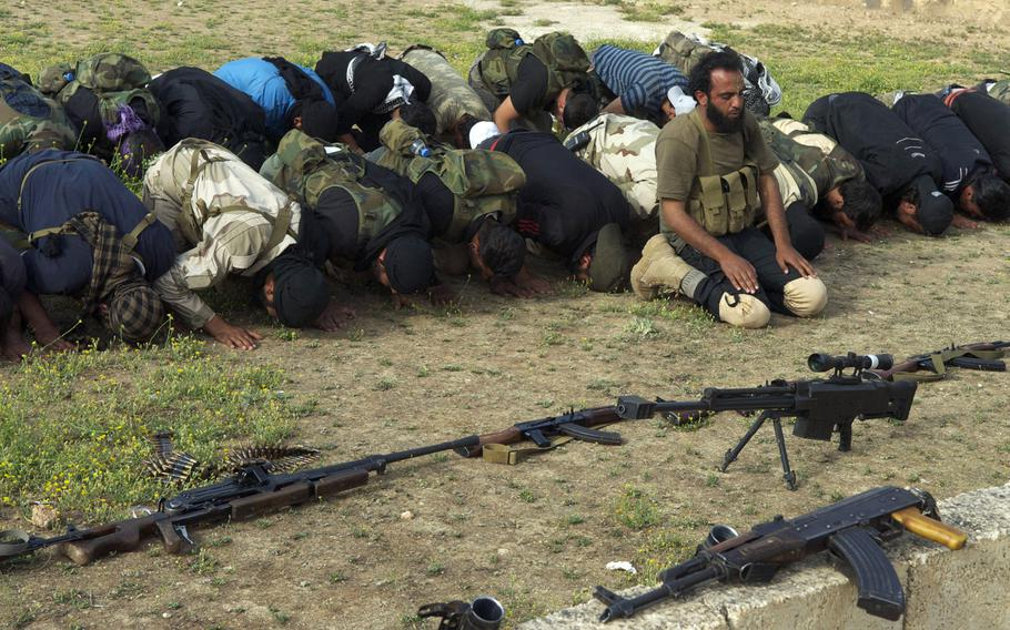Syrian rebels from the Grandsons of the Prophet Brigades pray before a battle at Abu Duhor miltiary airport in northern Syria. Rebels have continued offensives in northern and central Syria even as ammunition and other support for them has slowed in past months.