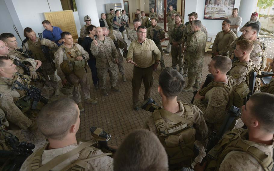 Deputy Secretary of Defense Ashton B. Carter, addresses troops as he surveys  the damage to the U.S. Consulate in Herat, Afghanistan, Sept. 14, 2013.