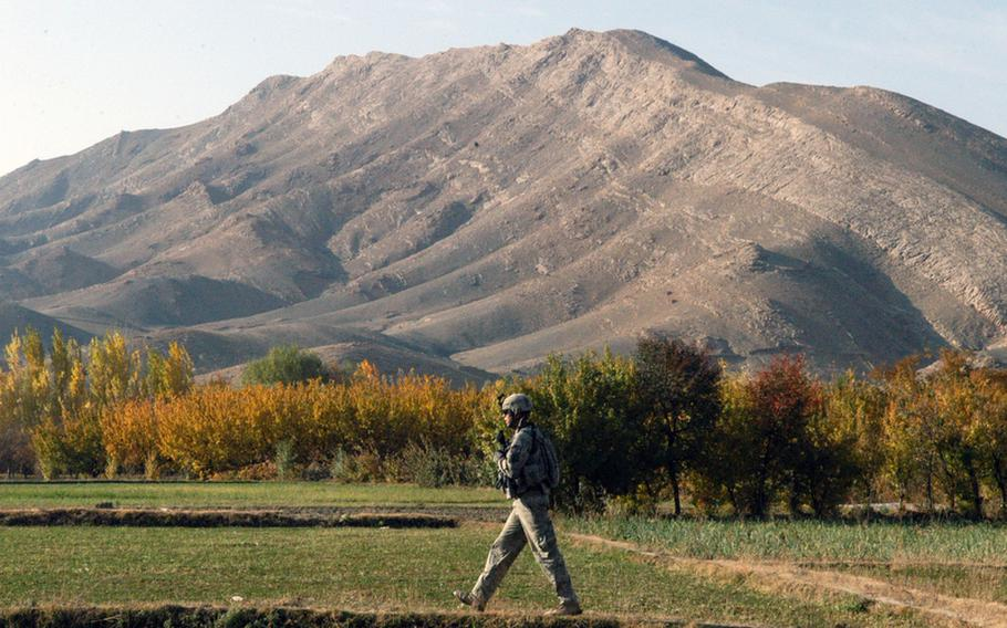 A soldier with 3rd Platoon, Company A, 2nd Battalion, 87th Infantry Regiment moves toward the site of a roadside bomb in the Tangi valley.