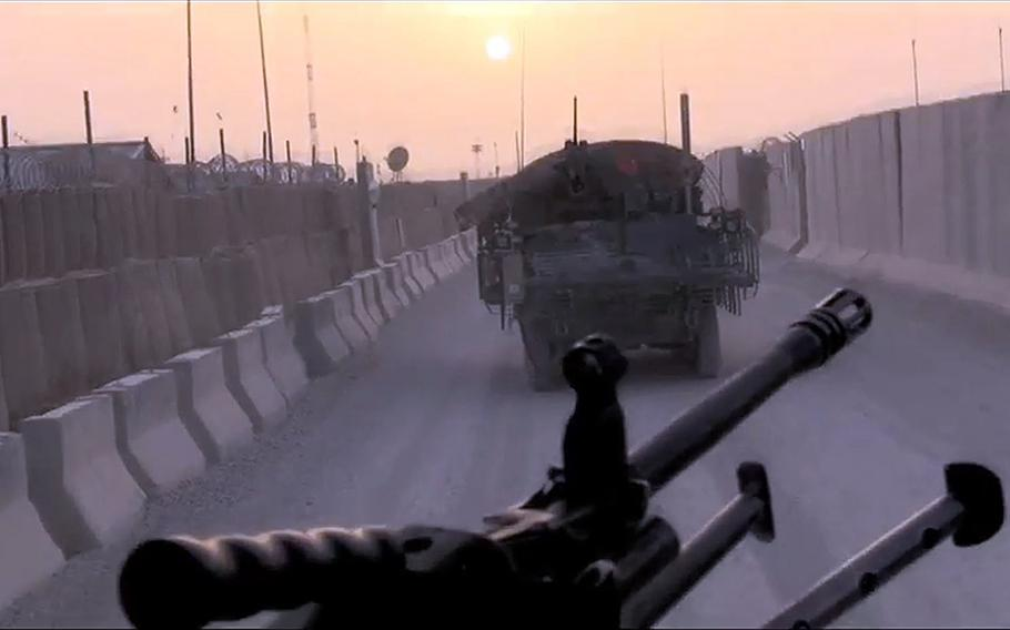 A video screen grab shows an ISAF vehicles patrol a section of Highway 1 in Afghanistan.