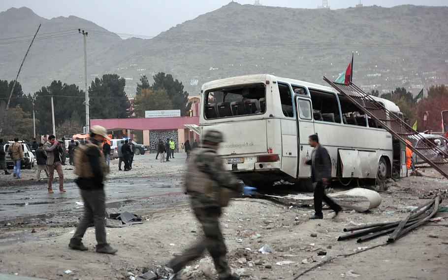 A damaged bus sits on the side of a road after a suicide car bomb attack Saturday, Nov. 16, 2013, in Kabul just across the street from a popular literature university in Kabul.  Alex Pena/Stars and Stripes