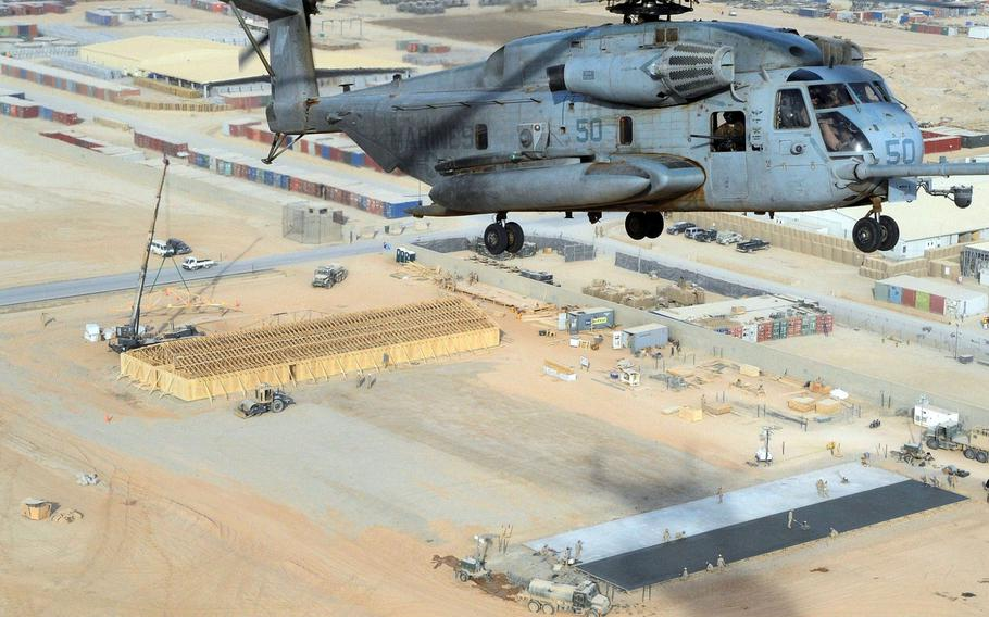 A CH-53 Sea Stallion helicopter flies over a Seabee project site at Camp Leatherneck in Afghanistan on Jan. 5, 2011.