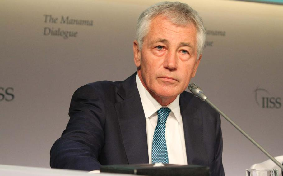 Defense Secretary Chuck Hagel prepares to speak at the Manama Dialogue, an annual security conference in Bahrain Dec. 7, 2013.