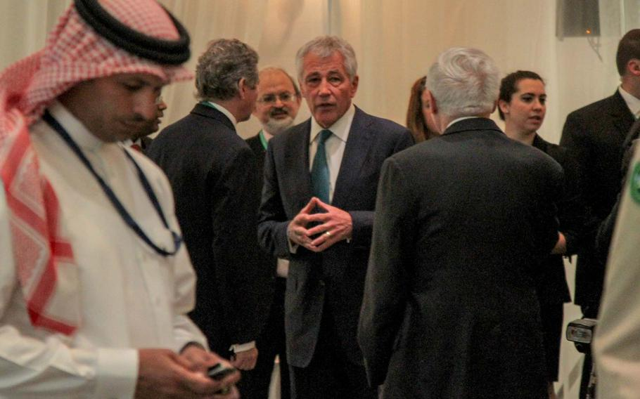 Defense Secretary Chuck Hagel mingles with delegates before his speech at the Manama Dialogue, an annual security conference in Bahrain, Dec. 7, 2013.
