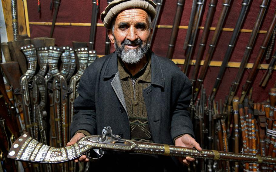 Sher Mohammed holds a replica jezail musket in his shop in downtown Kabul Jezails, which were originally handmade by Afghans during their fight against the British in the 19th century, have survived along with other antique guns as a popular souvenirs for American servicemembers.