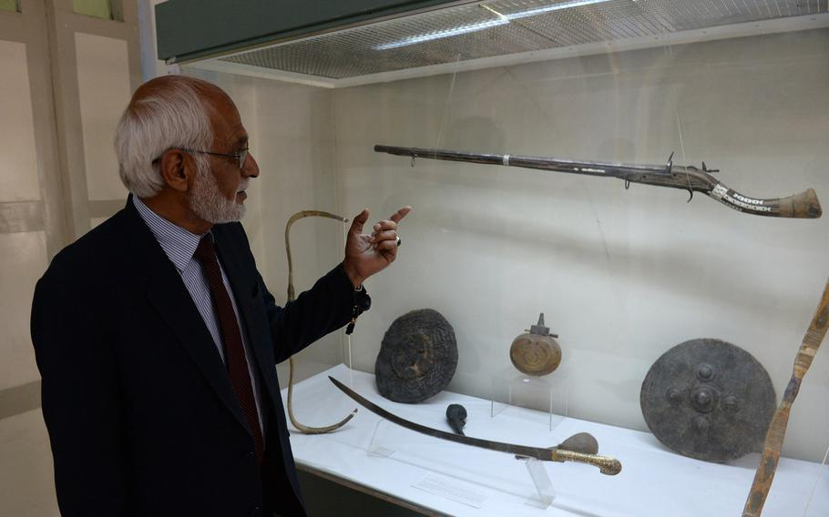 Omara Khan Massoudi, director of the National Museum of Afghanistan in Kabul, points to a jezail musket from the 19th century that is preserved in the museum's collection. He said Afghans often finely decorated such weapons with bits of shell or brass to make them stand out.
