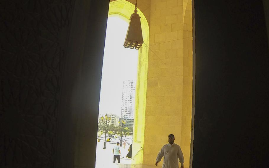 A man enters the Al Fateh Grand Mosque in Bahrain for afternoon prayer on Nov 20, 2013.