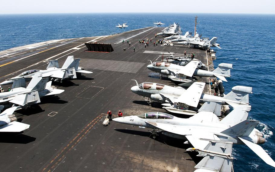 Two F/A-18 Hornet strike fighters launch simultaneously from the deck the USS George H.W. Bush, underway in the the Persian Gulf, Aug. 11, 2014.