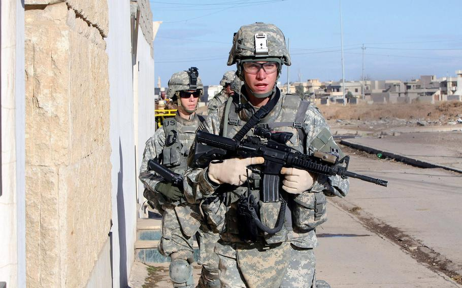 Soldiers from Red Platoon, Company A, 1st Battalion, 8th Infantry Regiment patrol the streets of Mosul, in northern Iraq, in February 2008.