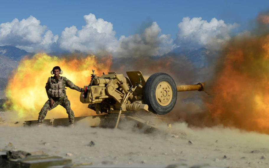 An Afghan National Army soldier fires a 122mm howitzer at Taliban positions during a clearing operation in Laghman province, Nov. 4, 2014. Security forces are struggling to make decisive gains in an insurgency that shows no signs of fading.