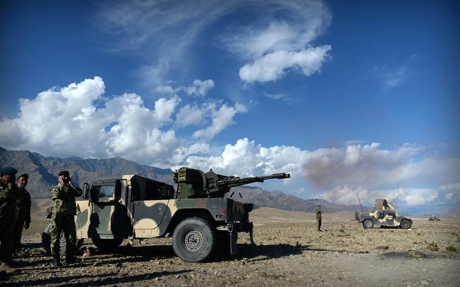 Afghan National Army soldiers fire a 23mm cannon at Taliban positions during a clearing operation in Laghman province, Nov. 4, 2014. Security officials say insurgents can't face off against government forces in head-on engagements, but they often return after the troops have left.