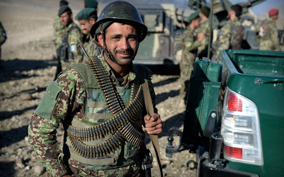 An Afghan National Army soldier walks to a truck after a clearing operation in Laghman province Nov. 4, 2014. Officials in the province say insurgents rarely stand and fight the army but often survive to return and plant bombs or pressure local residents.