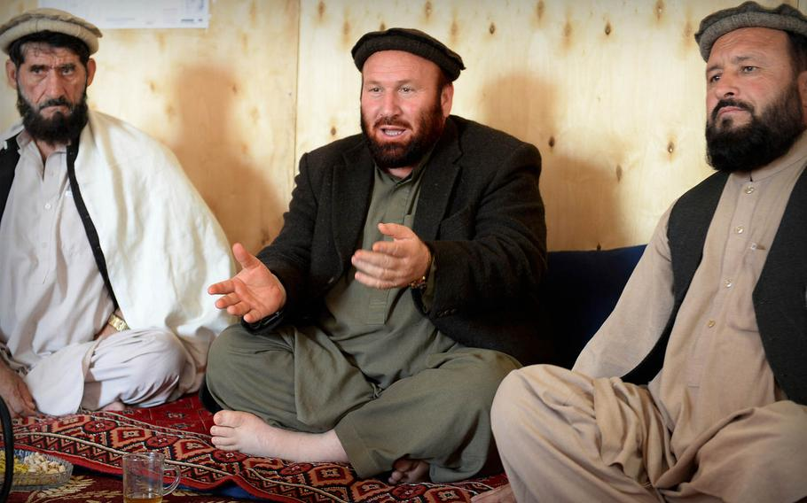 Afghan Local Police commander Haji Noorani, center, speaks to other police and tribal leaders in Laghman province Nov. 5, 2014. He offered a sober assessment of the situation in his province: 'The politicians say all is well, but it is not true.'
