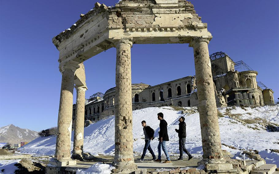Young men walk the grounds of Darulaman Palace in west Kabul.