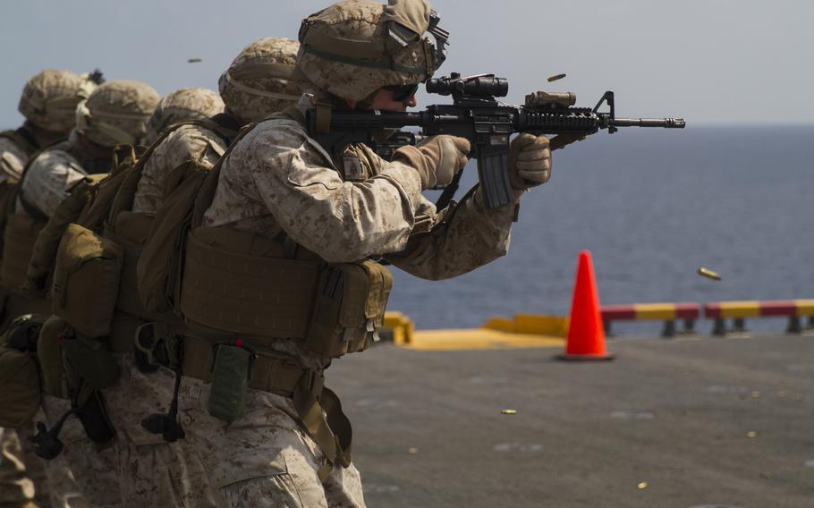 Marines from the 24th Marine Expeditionary Unit participate in a live-fire exercise aboard the amphibious assault ship USS Iwo Jima on Jan. 18, 2015. The Iwo Jima and the USS Fort McHenry have moved into the Red Sea for possible evacuation of U.S. Embassy workers from the Yemen capital of Sanaa.