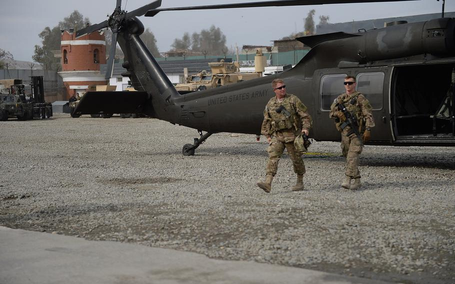 Army Brig. Gen. Christopher Bentley arrives at Afghan Uniformed Police Headquarters in Nangarhar Province, eastern Afghanistan, to discuss recent Afghan operations in Dangam and other areas along the Afghanistan-Pakistan border on Jan. 21, 2015.