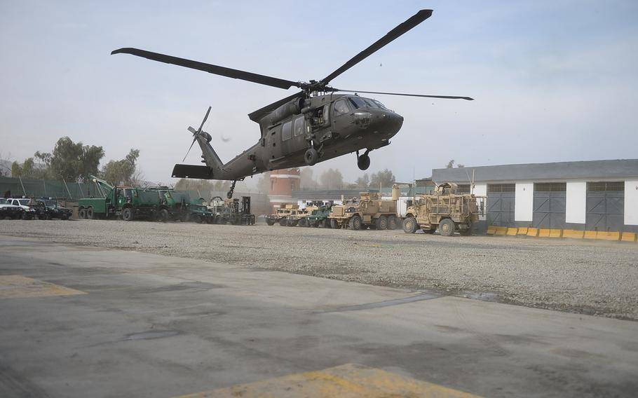 A U.S. Blackhawk carrying Brig. Gen Christopher Bentley, head of TAAC-East, and American advisers touch down at the provincial headquarters for Afghan Uniformed Police in Nangarhar province in eastern Afghanistan on Jan. 21, 2015. It was the Army general's first visit to the AUP outpost since taking command.