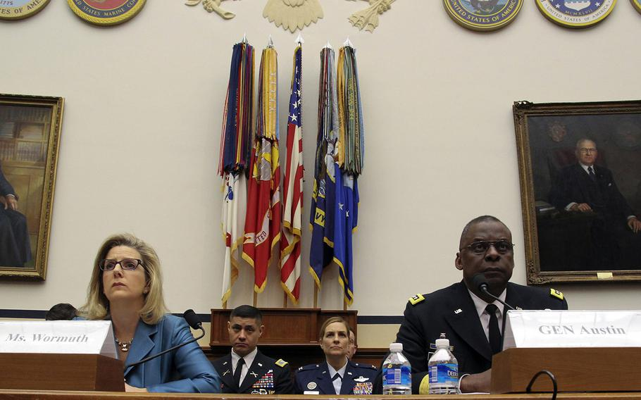 Undersecretary of Defense for Policy Christine Wormuth and CENTCOM Commander Gen. Lloyd Austin testify at a House Armed Services Committee hearing on Capitol Hill, March 3, 2015.