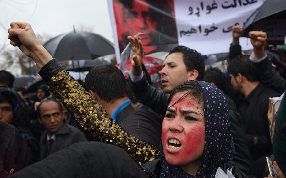 An Afghan protester, her face painted red to resemble a bloodied face, shouts slogans with others during a rally in front of the Supreme Court in Kabul to demand justice for Farkhunda, a woman who was beaten to death by a mob after being falsely accused of burning a Quran in March 2015.