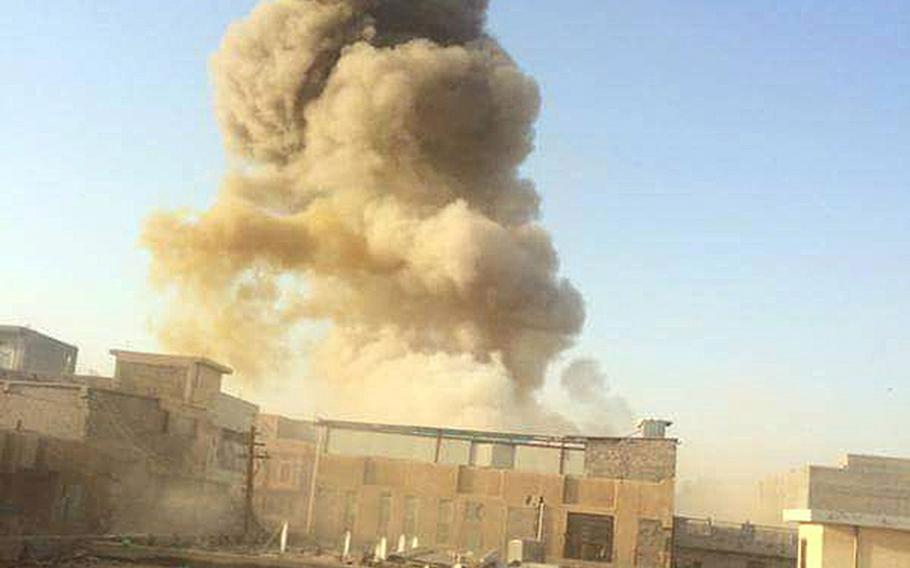An Islamic State car bomb explodes at the gate of a government building near the provincial governor's compound in Ramadi, Iraq, on Saturday, May 16, 2015, during heavy fighting that saw most of the city fall to the militants.