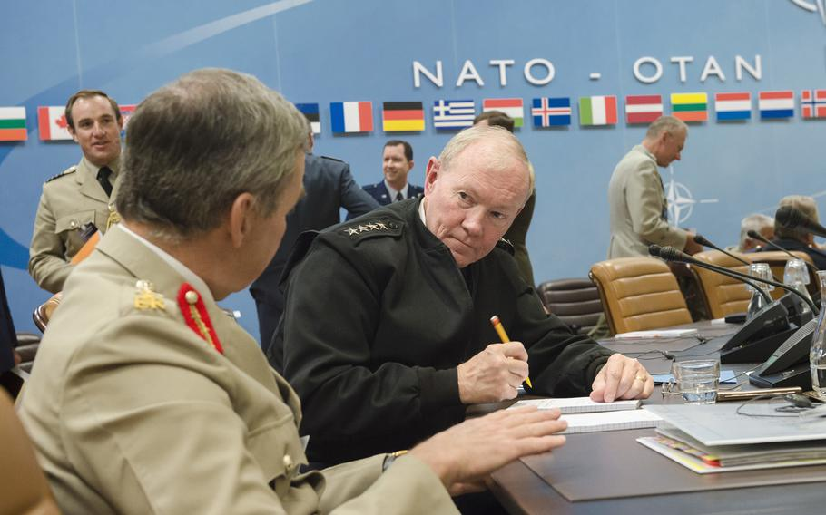 Joint Chiefs of Staff Gen. Martin E. Dempsey listens to Gen. Nicholas Houghton, Chief of the Defence Staff of the British Armed Forces, during the 173rd Military Committee in Chiefs of Defence Session at NATO headquarters in Brussels, Belgium, May 21, 2015.