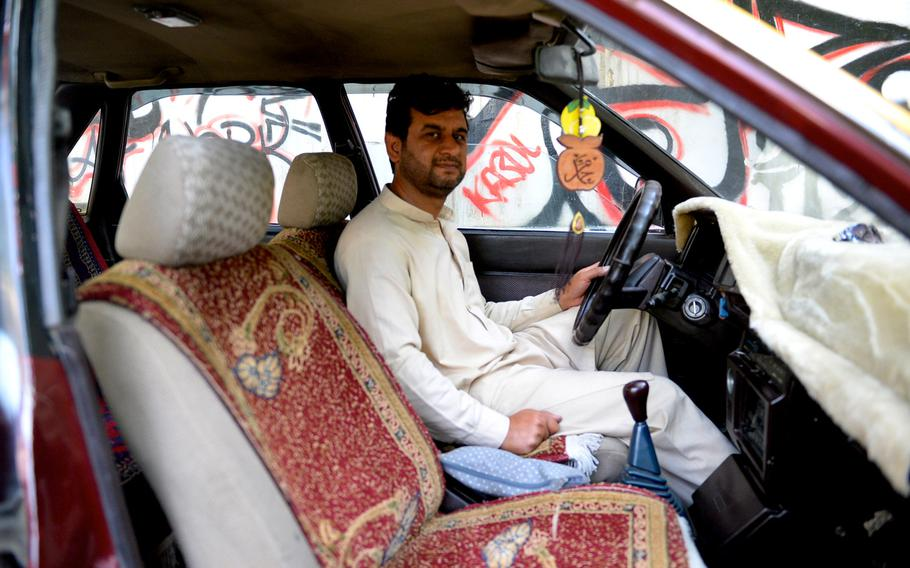 Shir Shah, a Kabul taxi driver, gets behind the wheel of his customized 1986 Toyota Corolla. The vehicle's affordability, fuel-efficiency and deft handling has made the Japanese import a favorite among Afghan drivers.