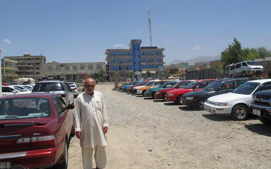 """Car dealer Haji Askar Khan shows off his fleet of of Toyota Corollas on his sales lot in eastern Kabul. ''I've never seen one junked unless it was totaled in an accident,"""" Khan said, """"and (even then) it was stripped and its usable parts recycled."""""""