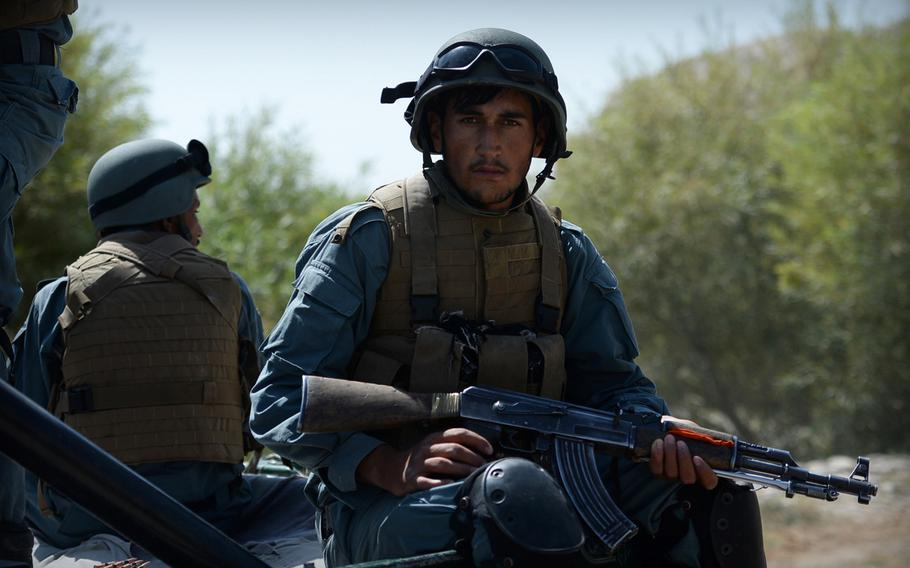 An Afghan policeman rides in the back of a truck during a patrol in Helmand province on Sept. 23, 2014. Afghanistan's National Directorate for Security spokesman Haseeb Sediqi said the Islamic State has gained footholds in Helmand, Nangarhar and Farah provinces.