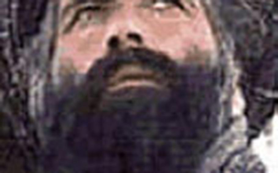In this undated image released by the FBI, Mullah Omar is seen in a wanted poster.