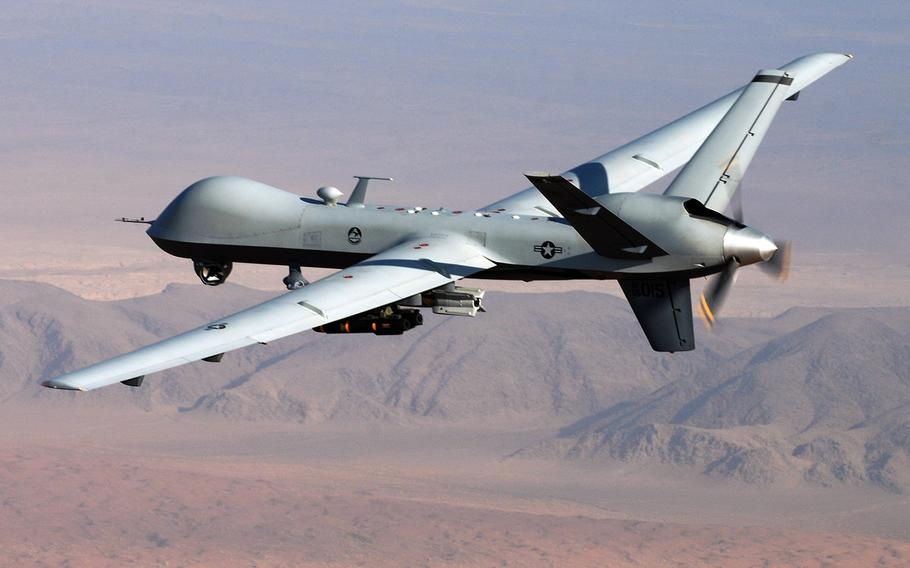 """An MQ-9 Reaper drone flies a combat mission over southern Afghanistan in this undated Air Force photo. More than a dozen Islamic State militants were killed in a drone attack in eastern Afghanistan Sunday night, just hours after President Ashraf Ghani said his country was becoming a """"graveyard"""" for members of the terrorist group."""
