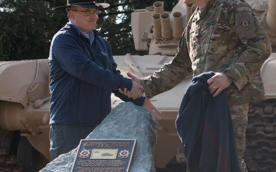 U.S. Army Lt. Col. Steven Gventer, right, and retired Lt. Col. Timothy Gauthier unveil a monument dedicated to the Battle of 73 Easting, on March 10, 2016, in Vilseck, Germany. This battle, in which Gauthier took part, was a decisive victory for the Army during the Gulf War.