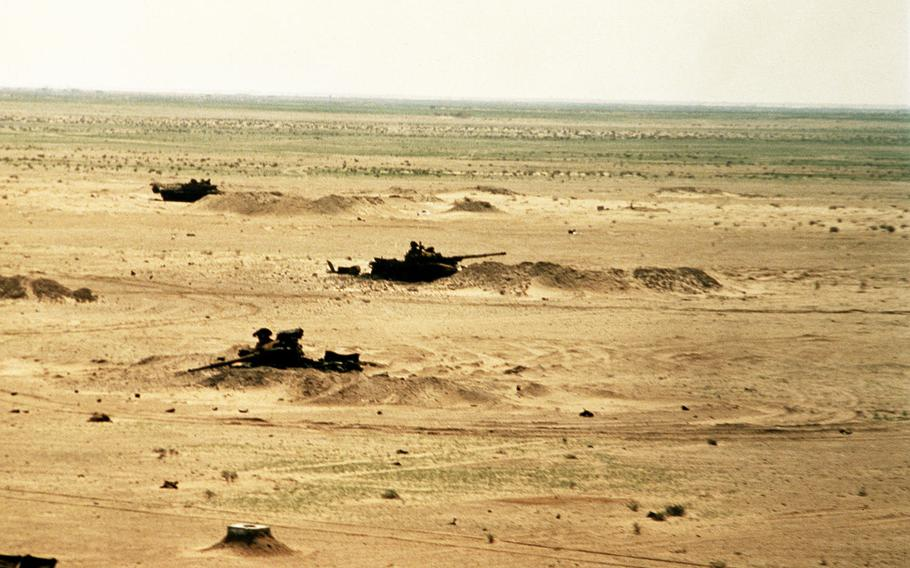 Burned out Iraqi T-72 tanks sit in the desert of southern Iraq during the Gulf War.