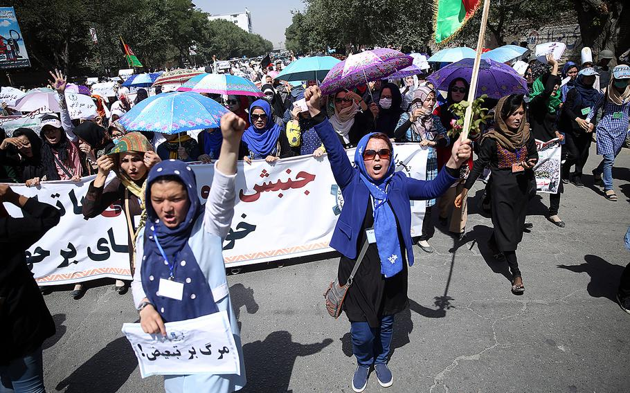 Thousands of demonstrators march towards the center of Kabul, Afghanistan, on Saturday, July 23, 2016, before a deadly blast struck the demonstration area.