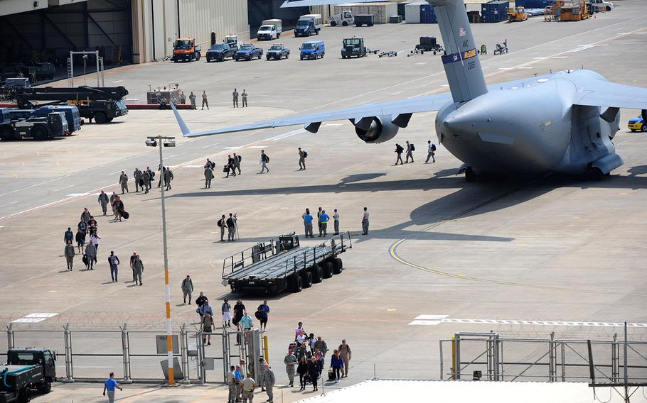 U.S. Air Force airmen exit a C-17 Globemaster III aircraft on July 22, 2016 at Incirlik Air Base, Turkey.