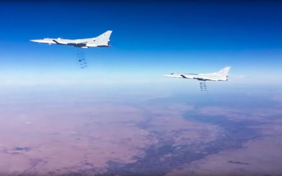 This photo provided by the Russian Defense Ministry Press Service shows Russian air force Tu-22M3 bombers strike Islamic State group targets in Syria on Tuesday, Jan. 24, 2017.