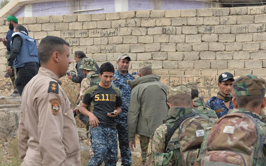 An Iraqi federal police officer in Hamam Alil, south of Mosul, wears what looks like a 5.11 Tactical shirt. The brand is popular among Iraqi forces fighting the Islamic State group for control of Mosul, but several impostors and clones are being sold in Iraqi markets.