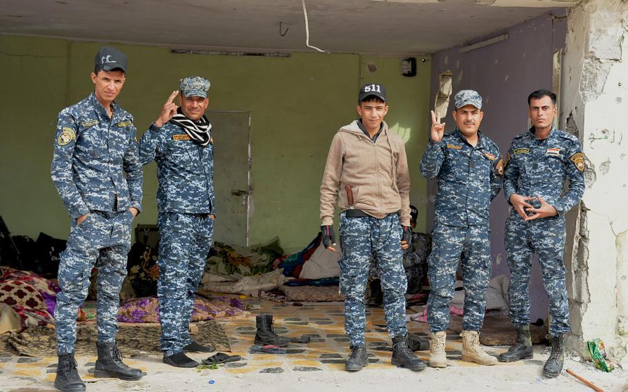 These Iraqi federal police officers in Hamam Alil are some of the many Iraqi forces sporting versions of 5.11 Tactical brand hats or their impostors. The man in the center wears a hat that says 511, a likely counterfeit.