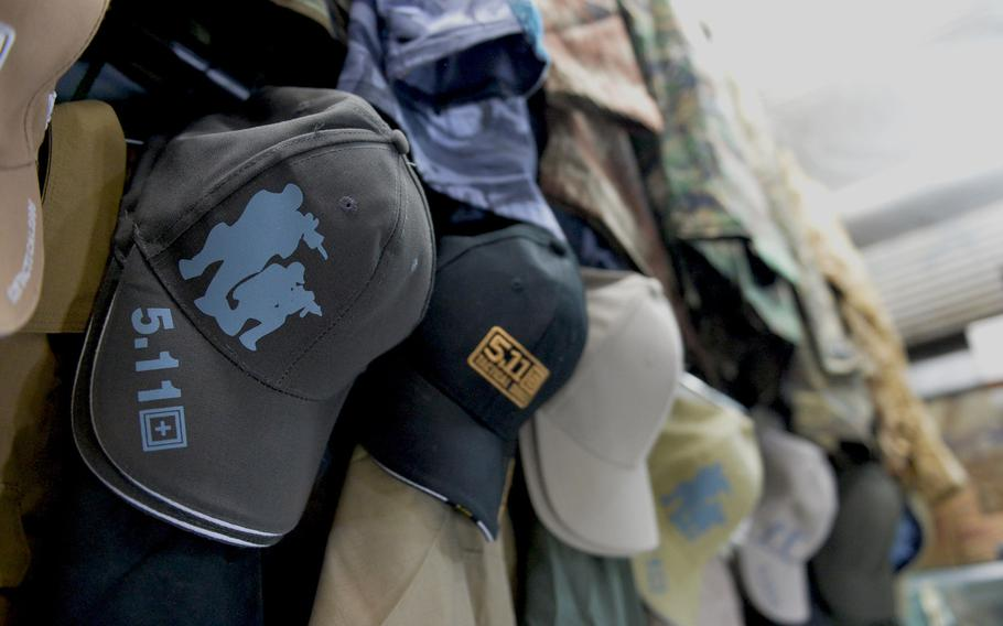 A row of hats marked with the 5.11 Tactical logo are on sale at an Irbil market on Friday, Dec. 23, 2016. Shops in Iraq are selling cheap counterfeits and knockoffs to Iraqi forces and civilians, some of whom say they buy the brand for its durability and suitability as battle gear.
