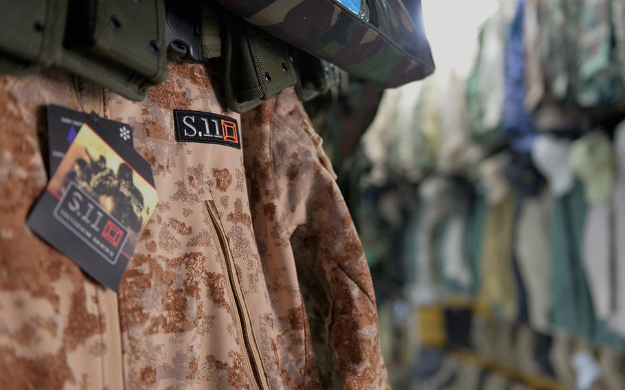 A camouflage jacket similar in style to one made by Irvine, Calif.-based 5.11 Tactical, but marked with the deceptively similar S.11 logo, hangs in a shop in Irbil, Iraq, Dec. 23, 2016.