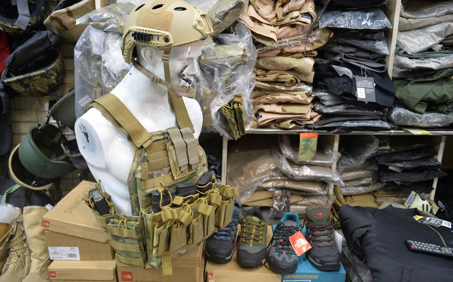 Tactical and outdoor gear, including boots marked with the North Face branding, are on display in a shop called Shanghai in Irbil, Iraq, Dec. 23, 2016. Fakes are not uncommon in Iraq, where security forces and others have popularized American brands like 5.11 Tactical, a company known for making durable clothes and accessories.