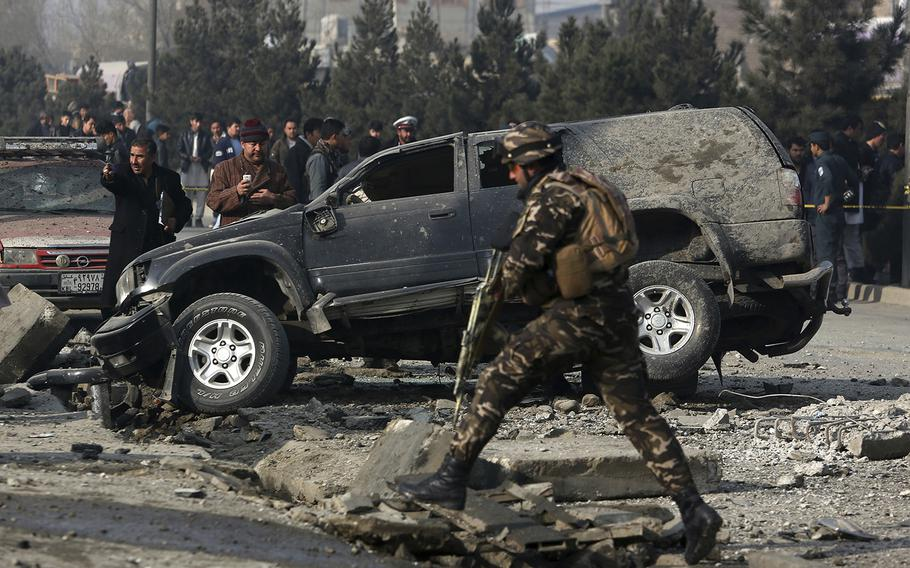 Afghan security personnel inspect the site of a roadside bomb blast in Kabul, Afghanistan, Wednesday, Dec. 28, 2016. A U.N. report released Monday said that a record number of civilians were injured or killed in 2016 in the war in Afghanistan.