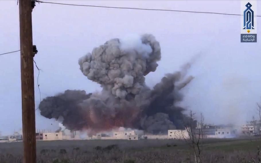 A screen grab from a video posted March 22, 2017, shows black smoke rising after a suicide bomber from the militant group of Levant Liberation Committee, attacked a Syrian government forces position, in Souran Town, northern Hama, Syria.