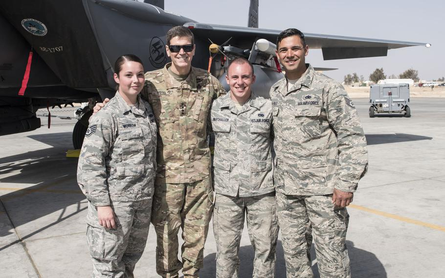 Staff Sgt. Alexandria Morrow, from left, 332nd Air Expeditionary Maintenance Squadron weapons load crew chief, Gen. Joseph L. Votel, U.S. Central Command commander, Senior Airman Lucas Marthaller, 332nd EMXS, and Staff Sgt. Carlos Olivarez, 332nd EMXS, on Feb. 23, 2017, in Southwest Asia. Morrow died from injuries sustained while performing work duties in support of Operation Inherent Resolve.