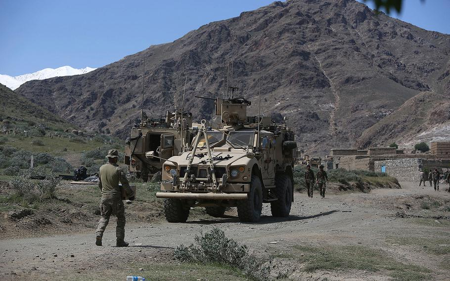 U.S. forces and Afghan commandos are seen in Asad Khil village near the site of a U.S. bombing in the Achin district of Jalalabad, east of Kabul, Afghanistan, Saturday, April 17, 2017.