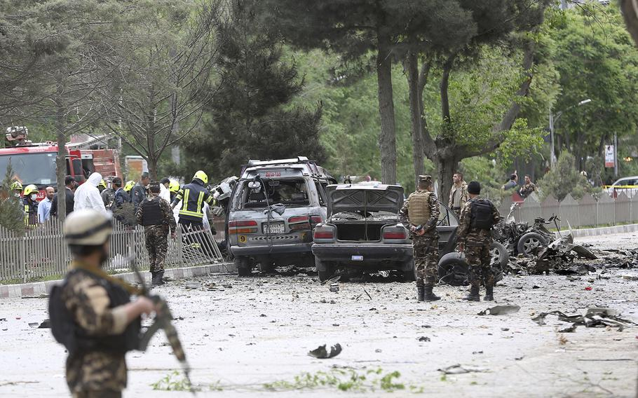 Security forces inspect the site of a suicide attack in Kabul, Afghanistan, Wednesday, May 3 , 2017.  Afghan officials say three U.S. soldiers were wounded in the attack.
